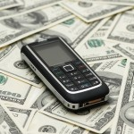 bigstock_Mobile_Phone_And_Dollar_Bank_N_2543038